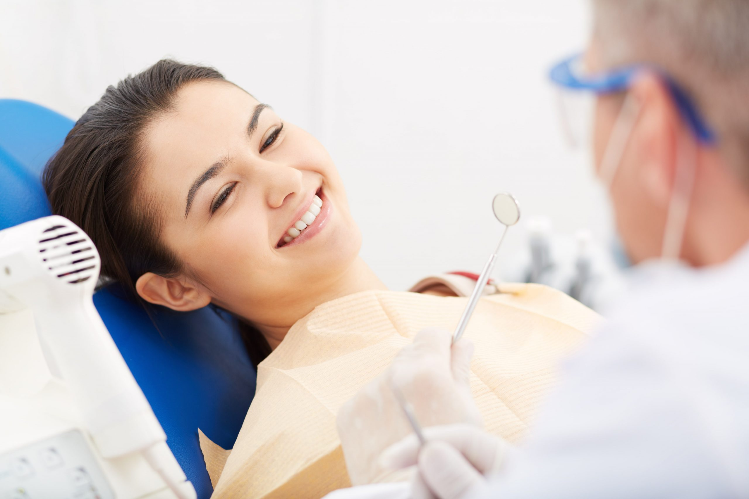 Patient happy after dental scaling procedure