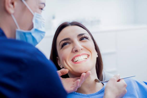 Woman visiting her dentist for dental fillings treatment