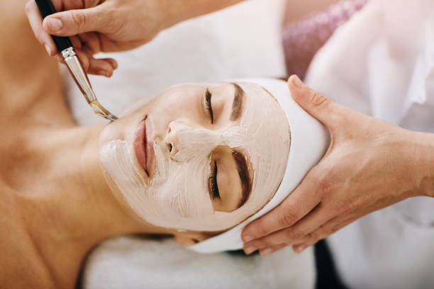 Shot of an attractive young woman getting a chemical peel treatment