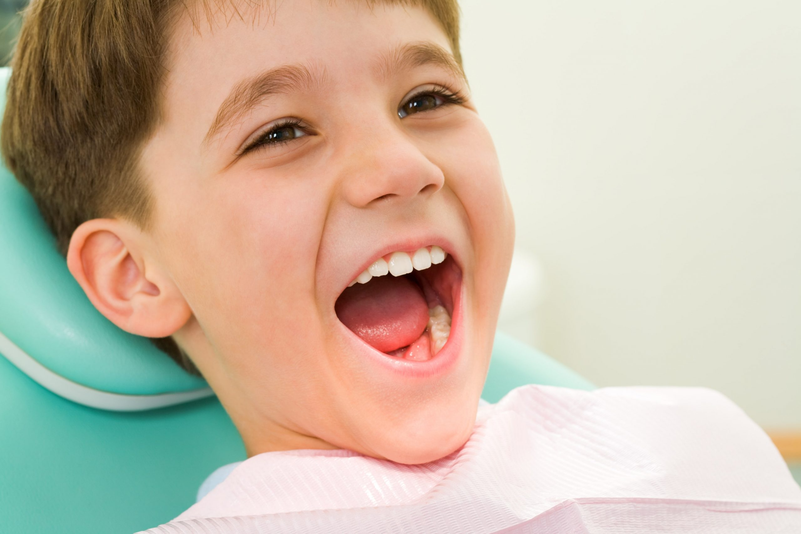 a young boy undergoing dental whitening