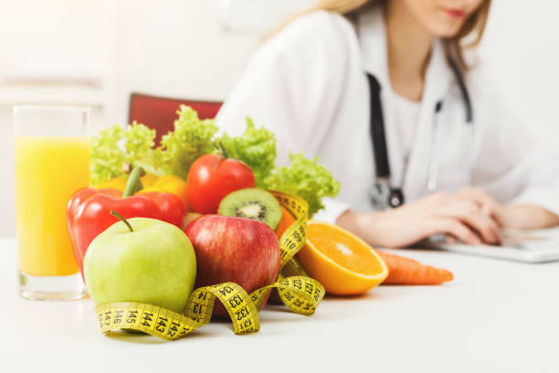 Dietician working a diet plan to treat obesity