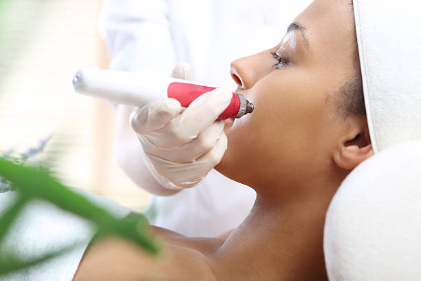 Microneedle mesotherapy, treatment for neck, the woman at the beautician