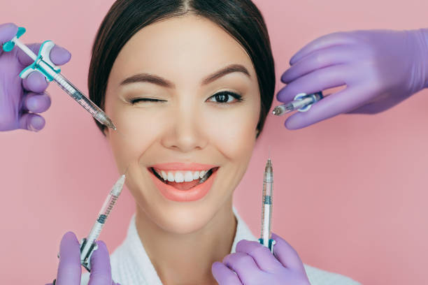 Portrait of a beautiful winking woman and many syringes with beauty injections around her face