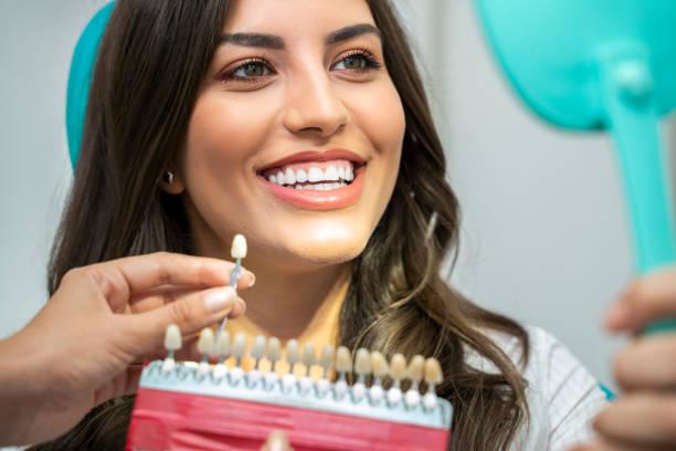 dentist examining teeth before teeth whitening